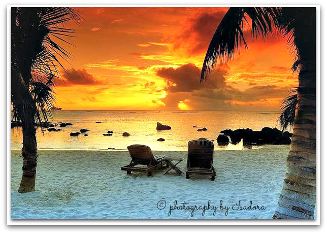 Sunset with beach chairs.web